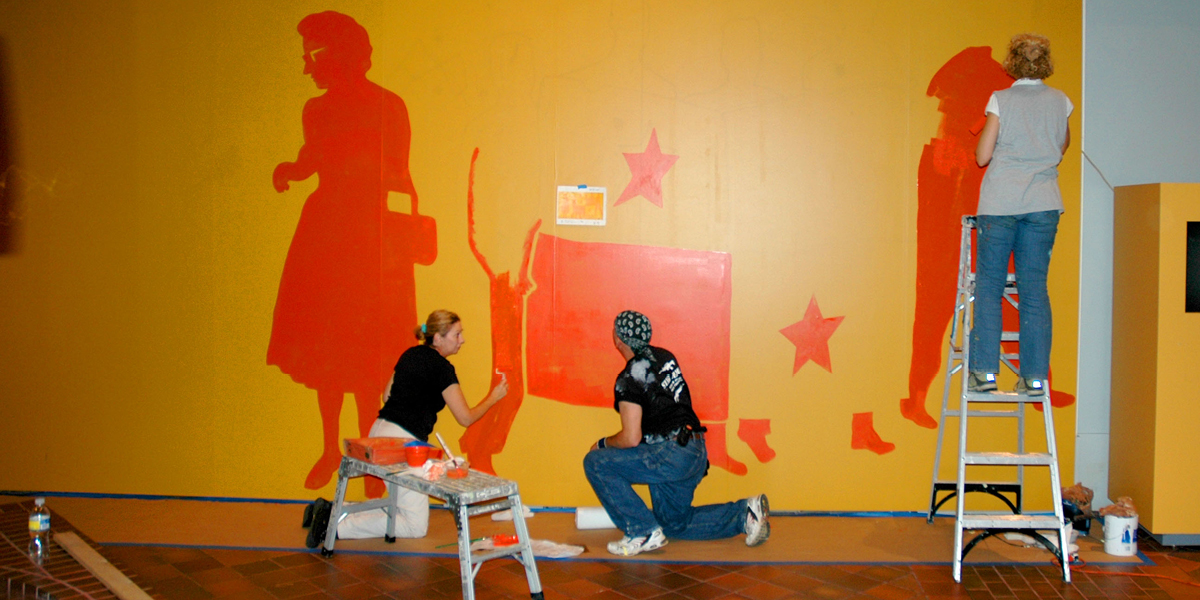 Painting a mural for a Latino Exhibition